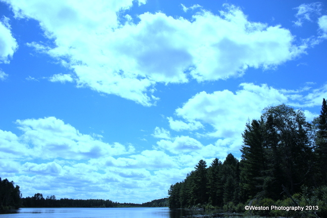 Beautiful clouds over Grove Lake Otter Lake, Quebec Canada