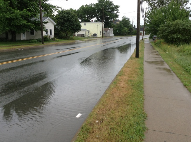Puddle from lots of rain Sydney, Nova Scotia Canada