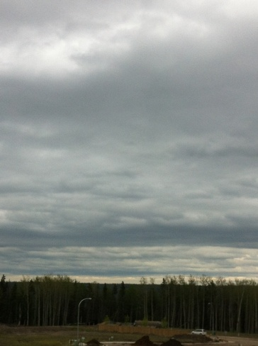 layers of rain clouds Fort McMurray, Alberta Canada