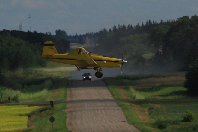 Crop Duster and car. Poplar Point, Manitoba Canada