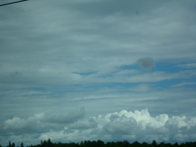White clouds over trees like mts Elliot Lake, Ontario Canada