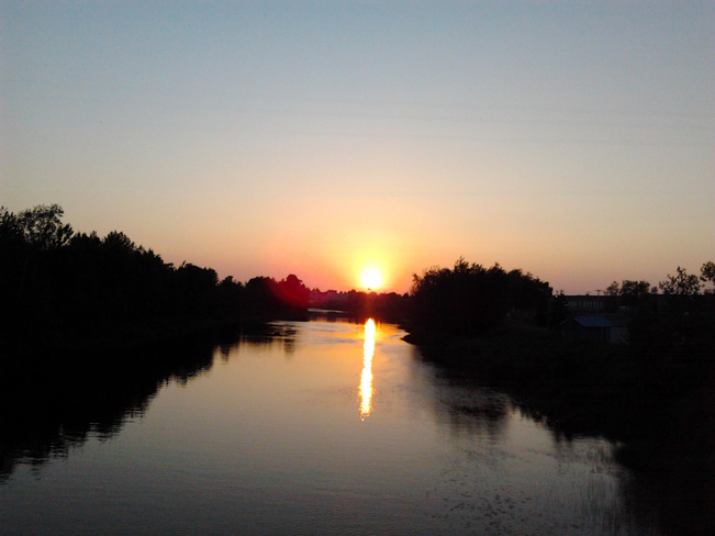 Sunset on river Timmins, Ontario Canada