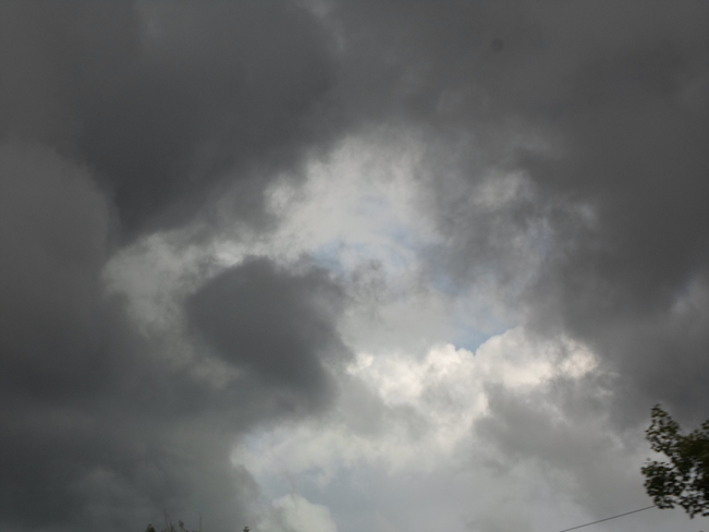 Very Dark Cloud,with blue centre Elliot Lake, Ontario Canada