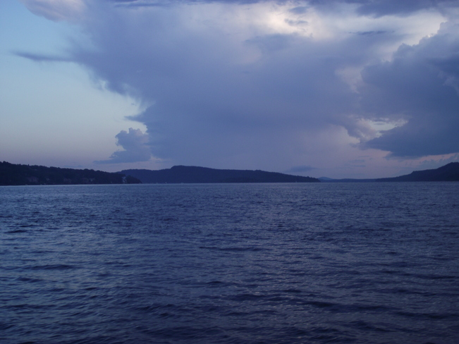 storm crossing river Quispamsis, New Brunswick Canada