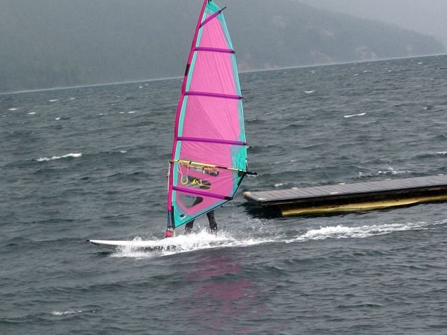 Windsurfing on Slocan Lake. Slocan, British Columbia Canada