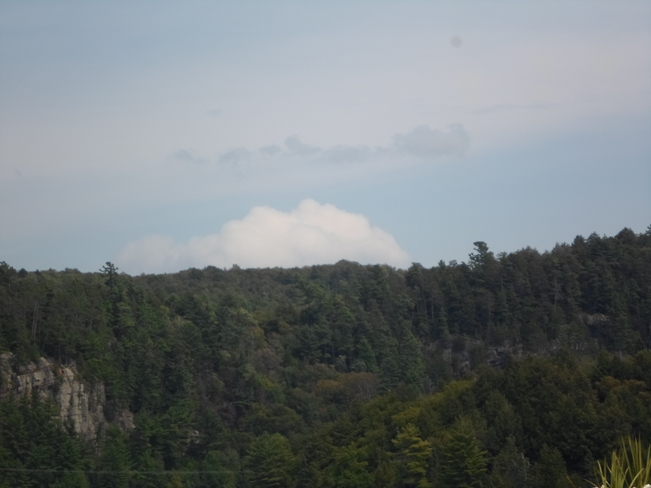 cloud resting above the trees Elliot Lake, Ontario Canada