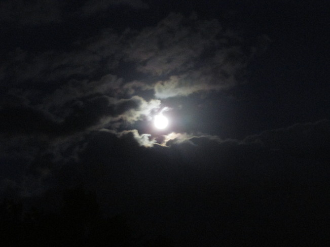 Glowing moon surrounded by clouds Riverview, New Brunswick Canada