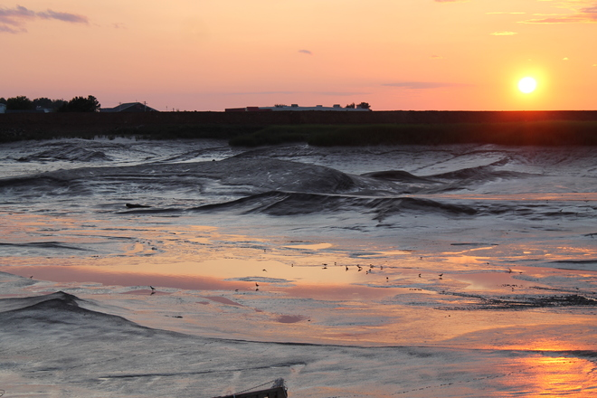 Sunset on Wolfville Harbour at low tide with the Pipers Wolfville, Nova Scotia Canada