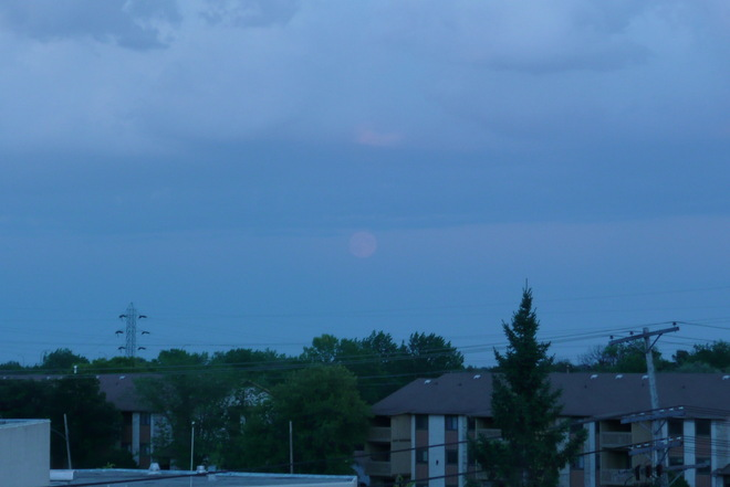 rain movin SE and moon rise Winnipeg, Manitoba Canada