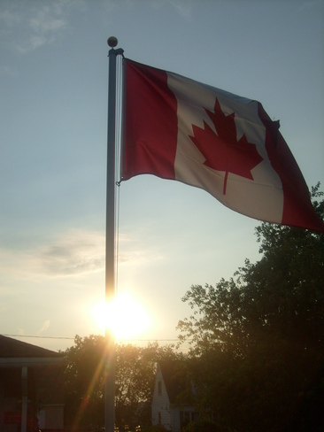 Flag in sunset St. Catharines, Ontario Canada