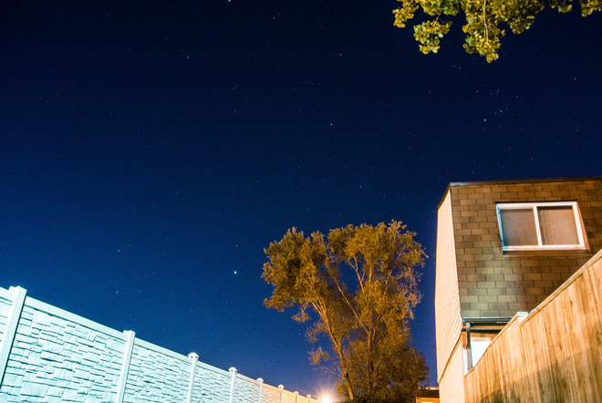 Hyades open star cluster (above the house roof), and Jupiter(to the left of the