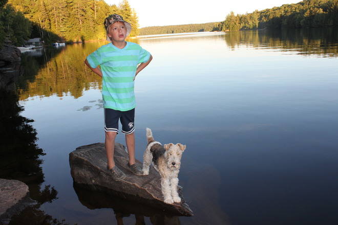 Child & Dog at Pine Grove Resort Port Loring, Ontario Canada