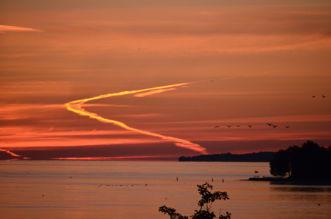 vapour trail at sunrise Barrie, Ontario Canada