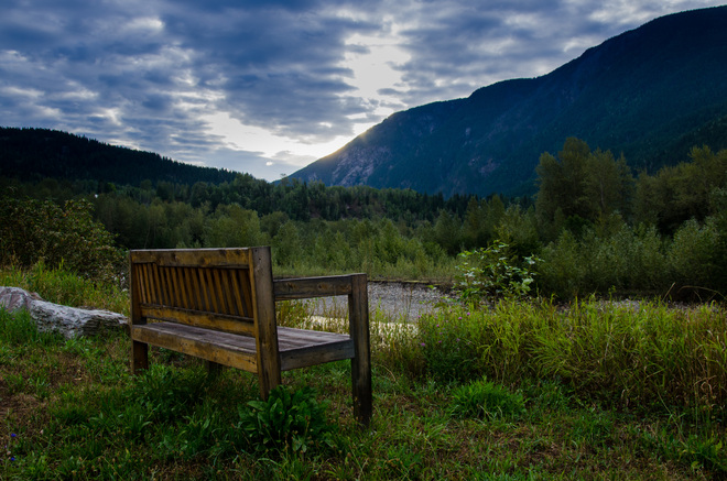 sitting by the river Revelstoke, British Columbia Canada