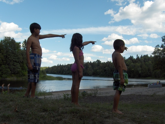 Kids Pointing @ Clouds Massey, Ontario Canada