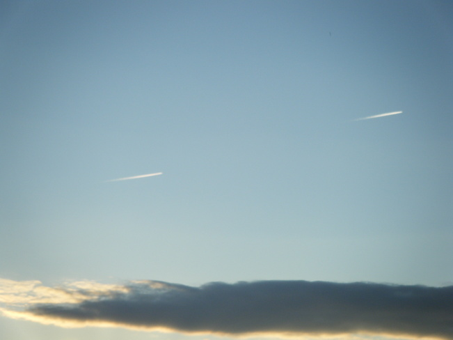 two planes soar above a dark cloud Moncton, New Brunswick Canada