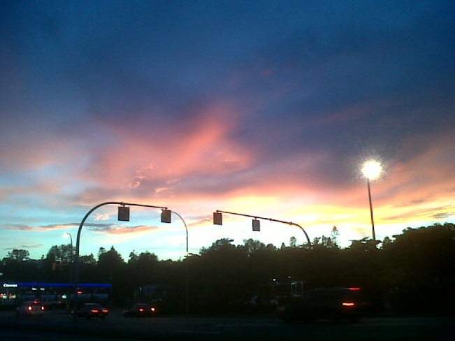 Pink clouds at intersection. Courtenay, British Columbia Canada
