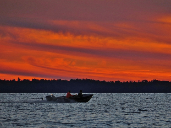 Heading out for an evening of fishing at sundown. North Bay, Ontario Canada