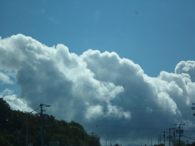 White fluffy clouds and blue sky Elliot Lake, Ontario Canada