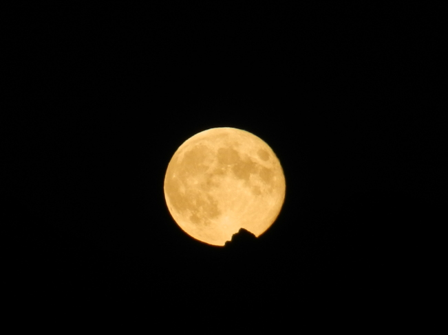 Harvest moon behind the mountains Chilliwack, British Columbia Canada