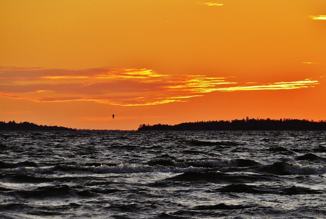 Wild waves, gentle sunset equals nice evening. North Bay, Ontario Canada