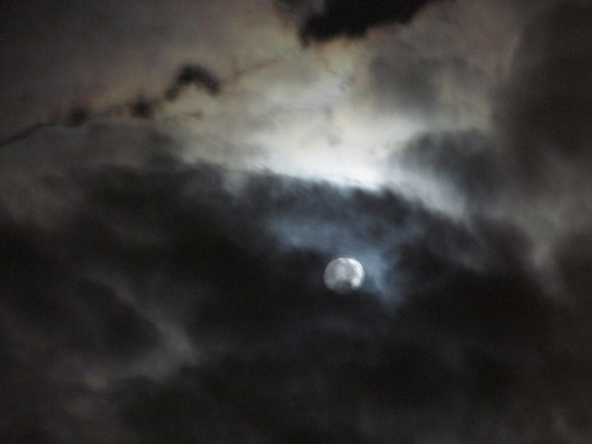 Dark clouds moving o'er the moon