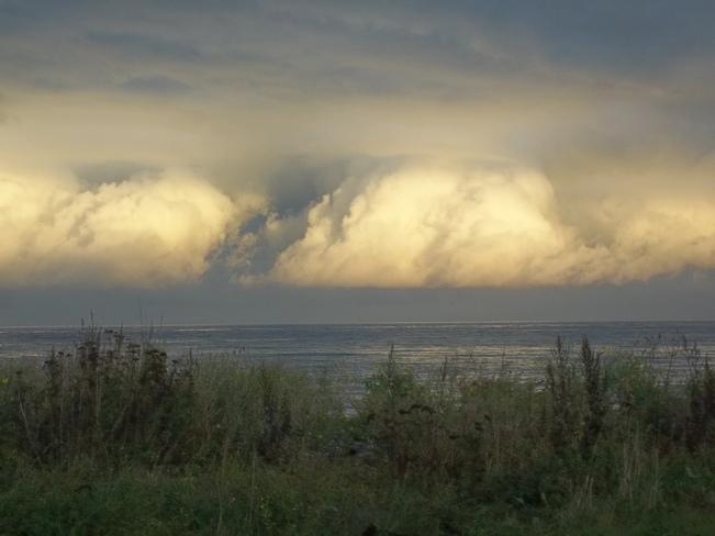 Sun going down, shining on the clouds Petit Rocher, New Brunswick Canada