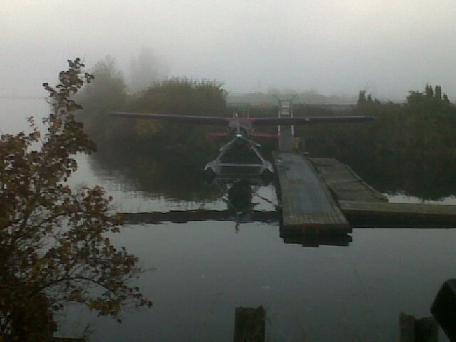 Water plane in fog. Courtenay, British Columbia Canada