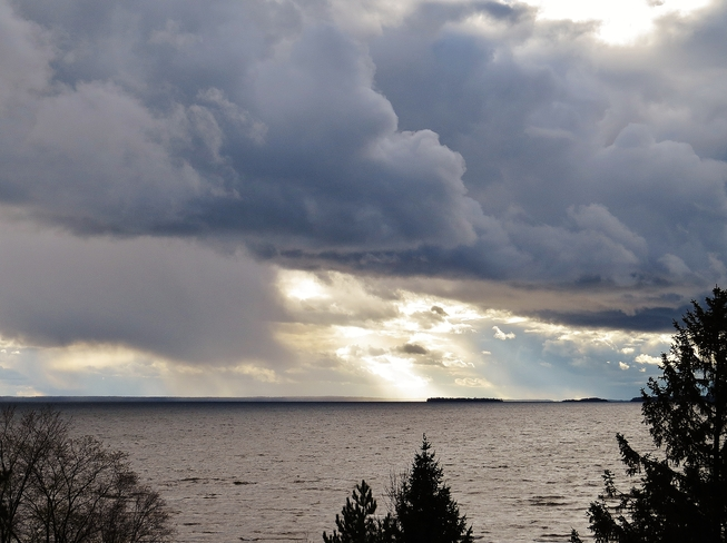 Storm clouds move in, sun close behind! North Bay, Ontario Canada