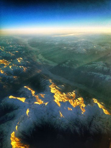 Gold Snow Mountains from the sky Calgary, Alberta Canada