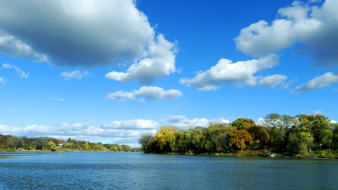 Blue clouds over Red River Winnipeg, Manitoba Canada