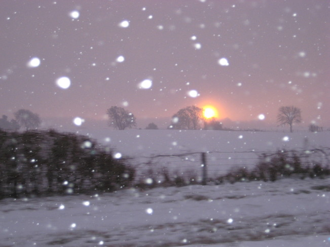 Sunrise during first snowfall of the year