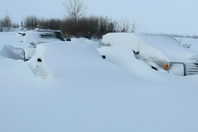 Vehicles Buried In The Drifts