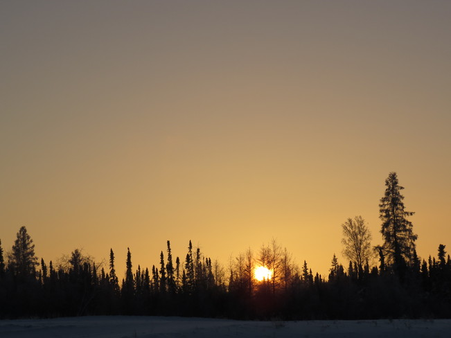 sun setting on a cold day Fort Mackay, Alberta Canada