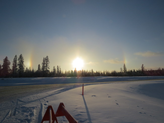 Sun dogs in the cold air Fort Mackay, Alberta Canada