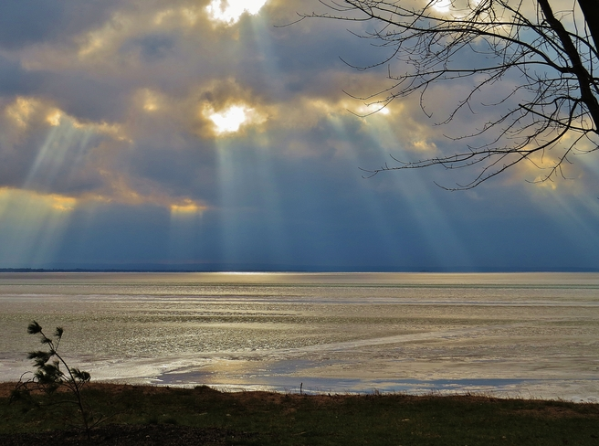 Rays breaking out all over the lake. North Bay, Ontario Canada