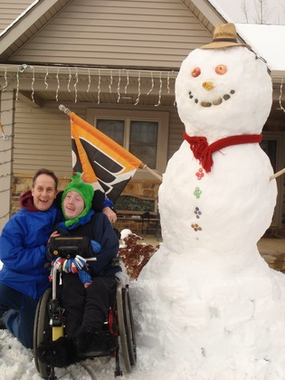 Aaron, Dad, and the 8.5 ft Snowman
