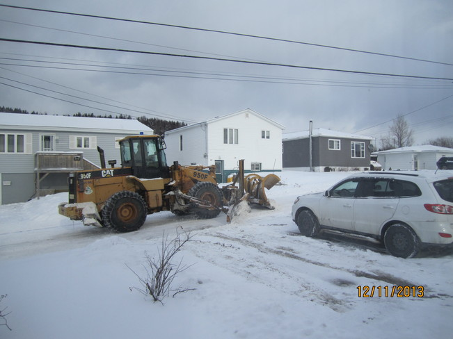 Cleaning up after snow squalls Corner Brook, Newfoundland and Labrador Canada