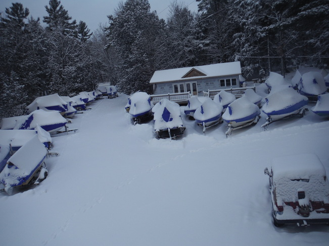 Snowmobilers Snow is here Kinmount, Ontario Canada
