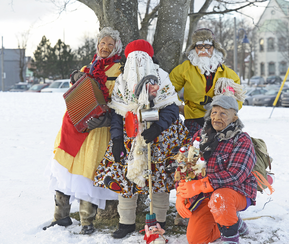 Mummers by the tree. St. John's, Newfoundland and Labrador Canada