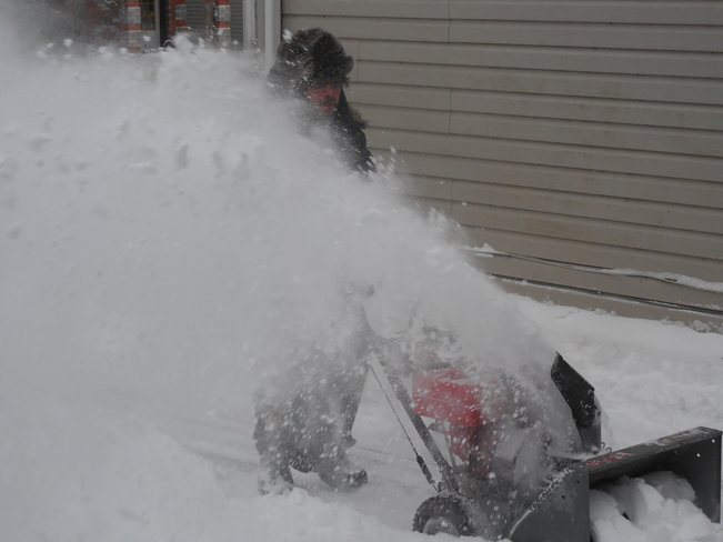 mike snowblowing Kingston, Ontario Canada