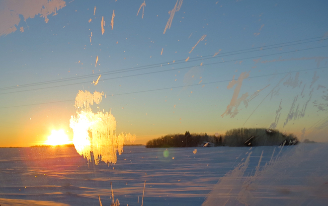 Frosty windows obscuring sunset Winnipeg, Manitoba Canada
