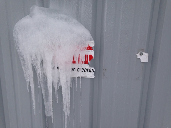 danger falling ice sign Fredericton, New Brunswick Canada