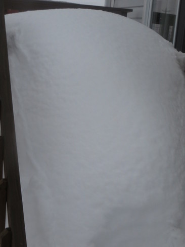 a load of snow on the deck Mount Pearl, Newfoundland and Labrador Canada