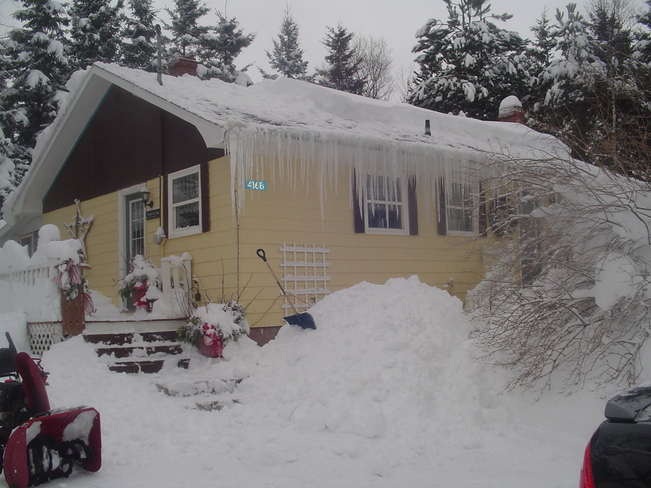 snow on roof O'Leary, Prince Edward Island Canada