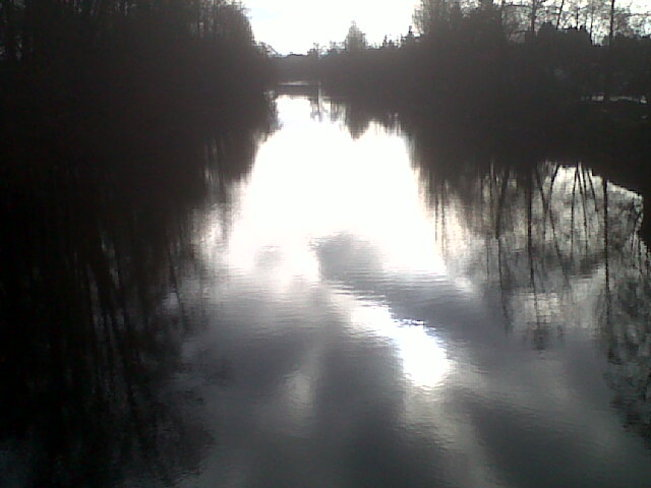 Courtenay River under partial clouds New years Eve