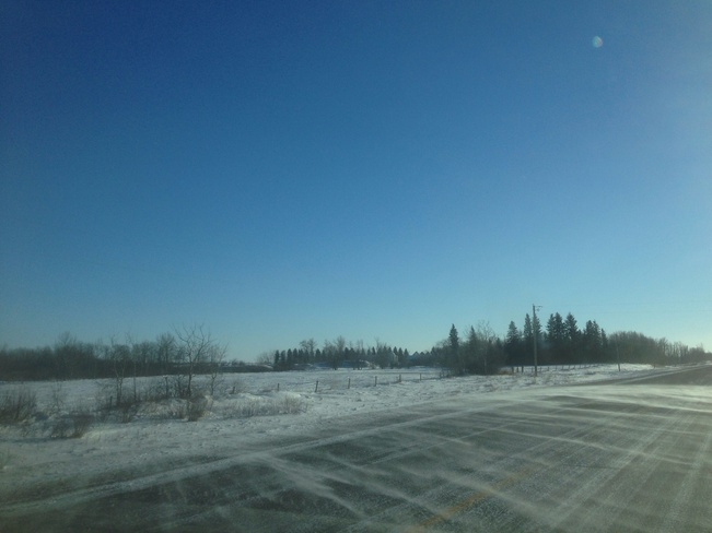 blowing snow on hiway 16 Minnedosa, Manitoba Canada
