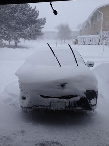 Car covered in snow Owen Sound, Ontario Canada