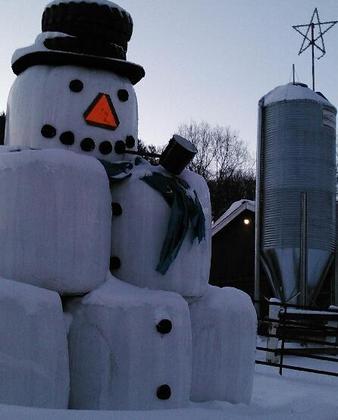Round bale snow man