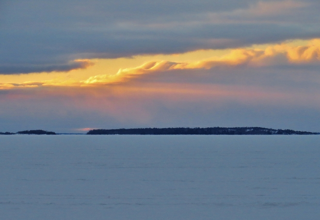 Small, colourful sunset over Manitou Islands Provincial Park. North Bay, Ontario Canada